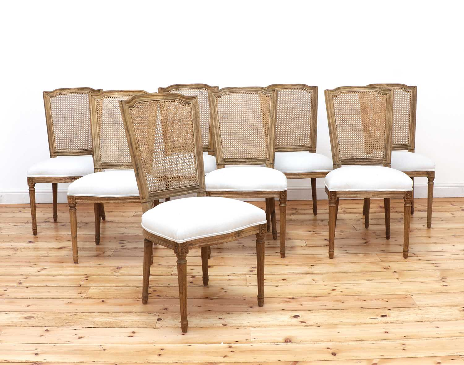 A set of eight modern bleached oak dining chairs,