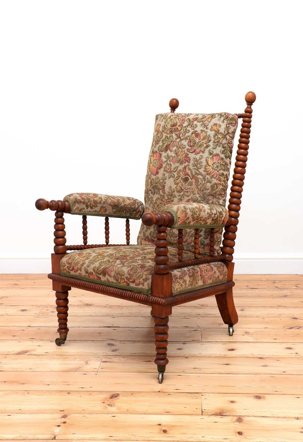 A Victorian fruitwood bobbin-turned library armchair,