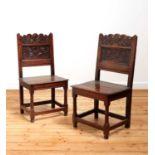 A pair of Charles II oak backstools,