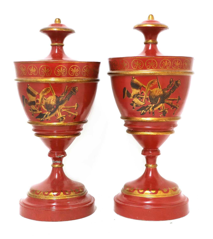 A pair of Regency-style toleware urns