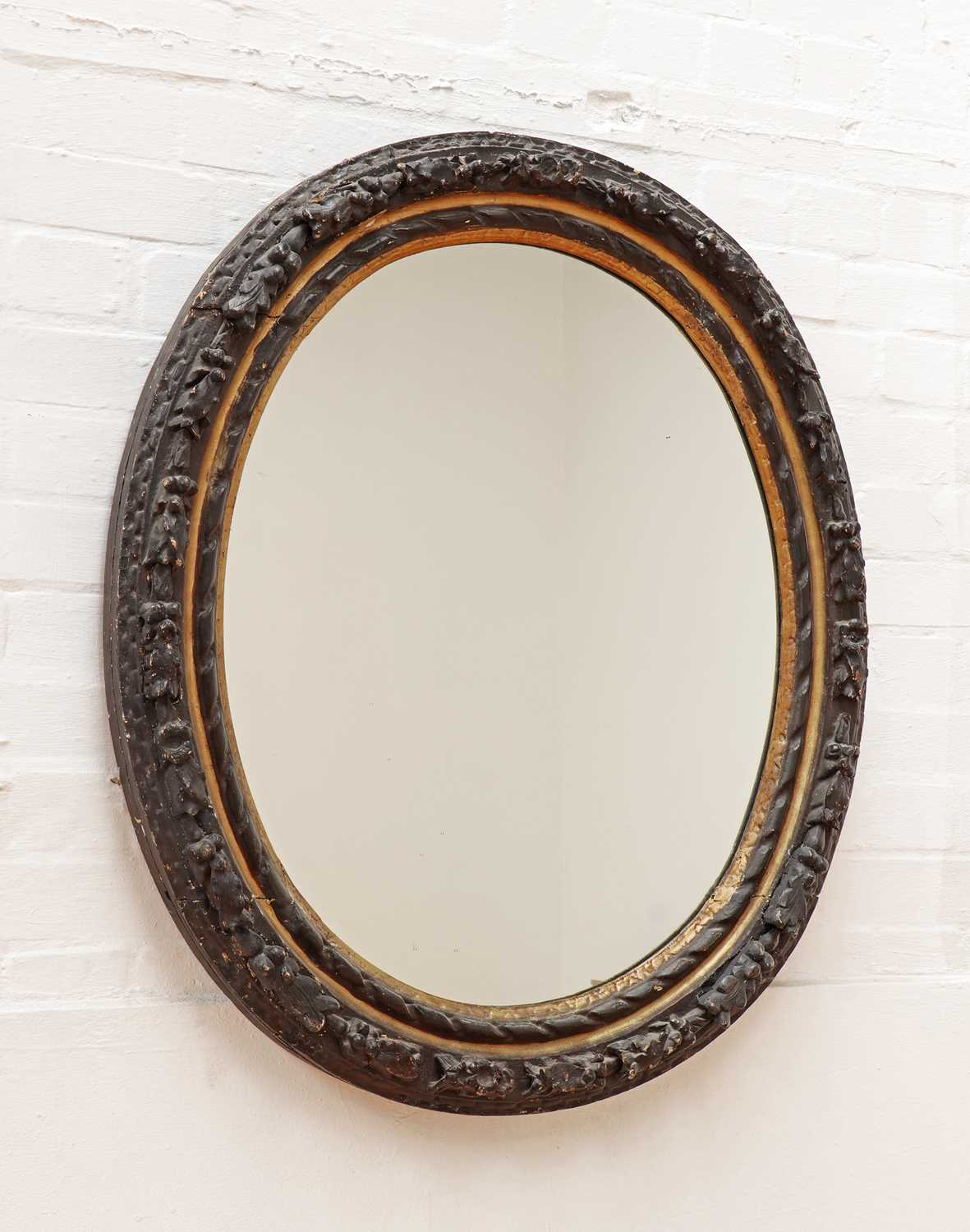 A carved giltwood and ebonised oval wall mirror, - Image 2 of 3