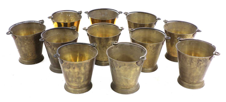 A set of eleven brass buckets,