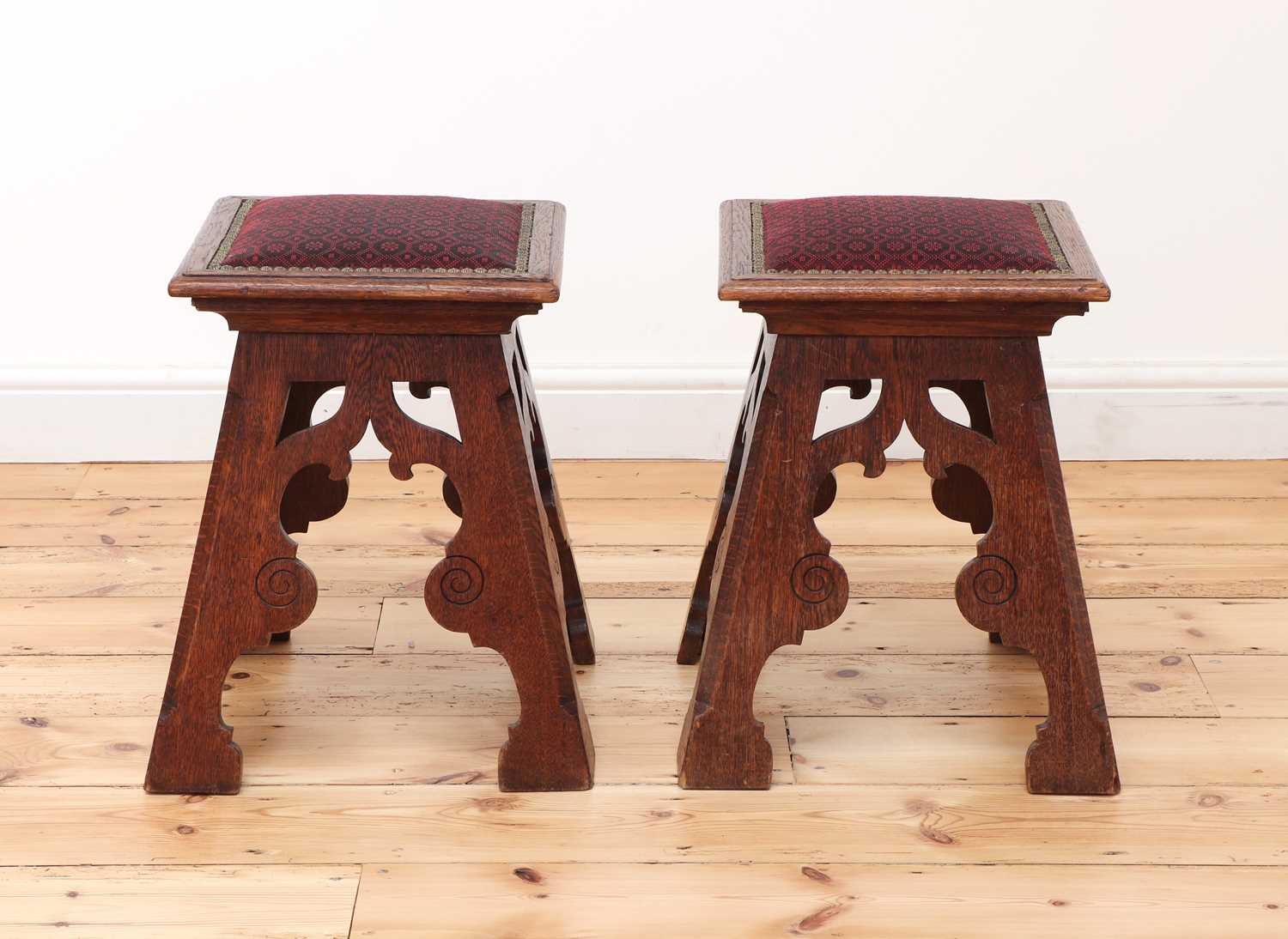 A pair of Liberty-style Arts and Crafts oak stools,