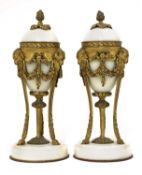 A pair of French Empire-style white marble and ormolu cassolettes,