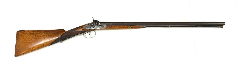 A 12-bore double-barrelled percussion shotgun,