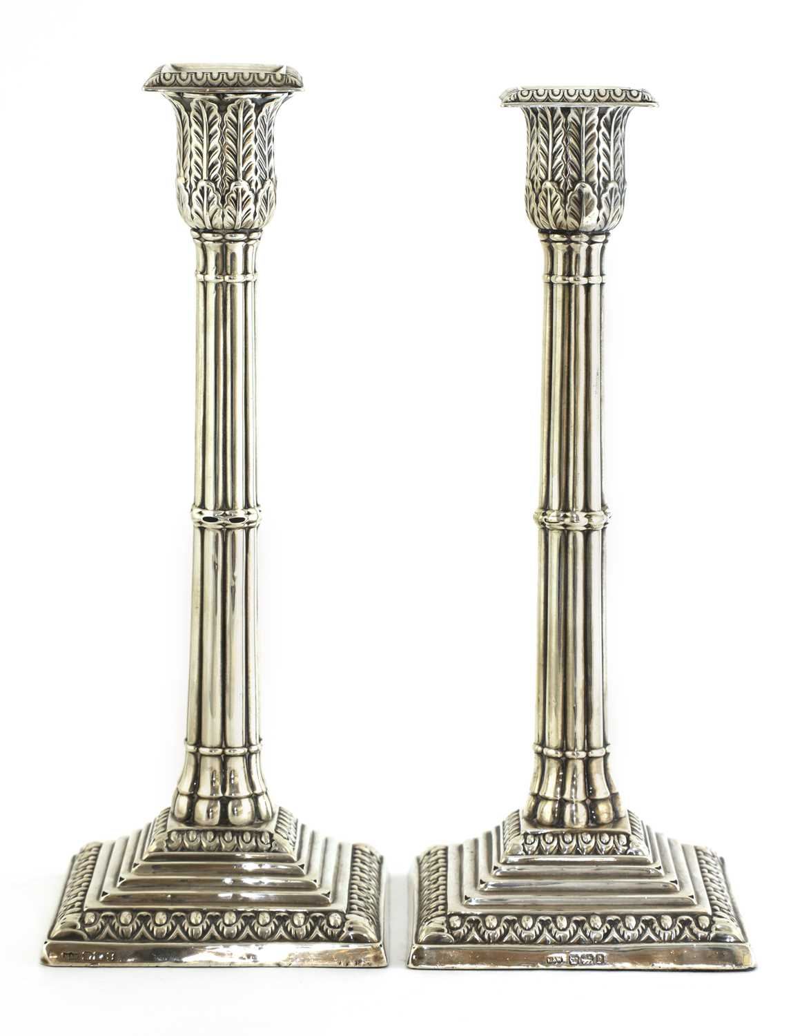 A pair of silver cluster column table candlesticks,
