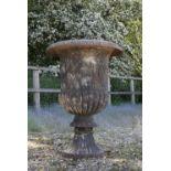 A cast iron campana garden urn,