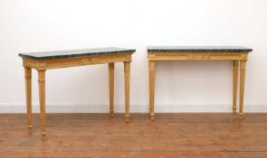 A pair of giltwood console tables in the manner of Robert Adam,