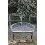 A Victorian wirework double garden seat,