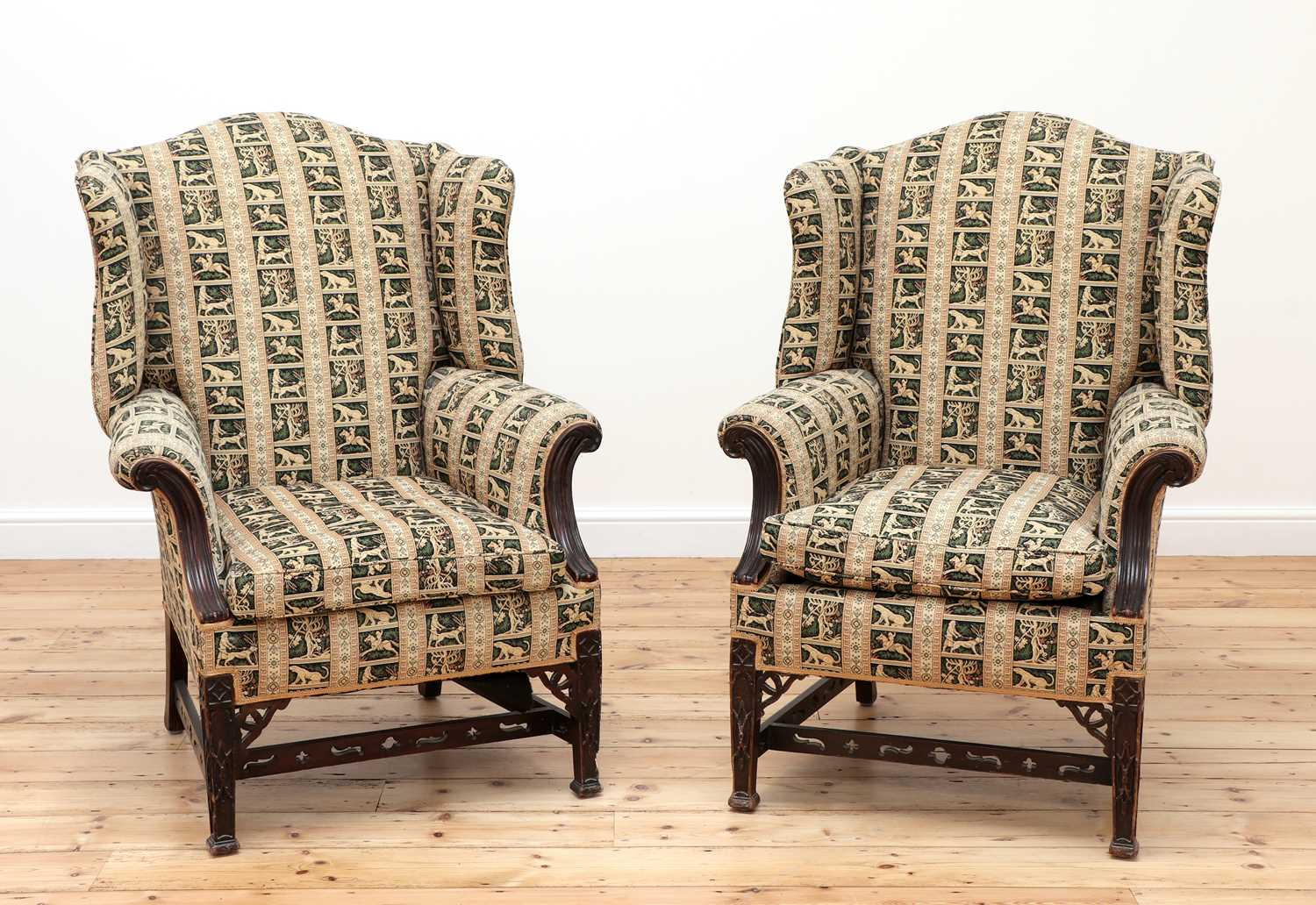 A pair of George III-style mahogany wingback armchairs