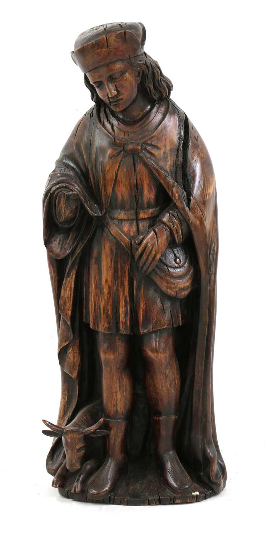 An Austrian carved wood figure of a hunter,