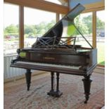 A Victorian mahogany baby grand piano by Bechstein,