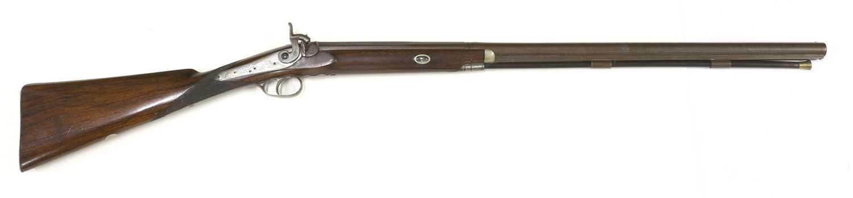 A single-barrelled percussion 12-bore shotgun,