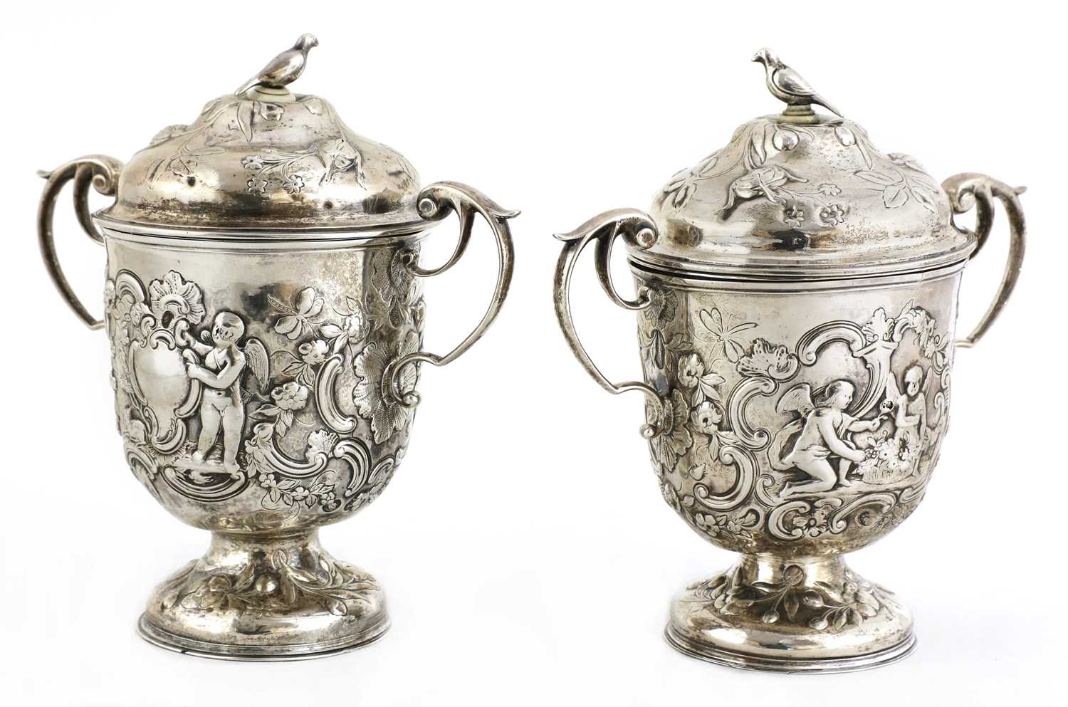 A pair of Continental silver urns,