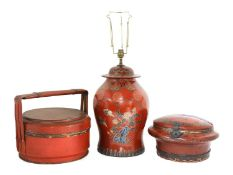 A Chinese red-lacquered food carrier,