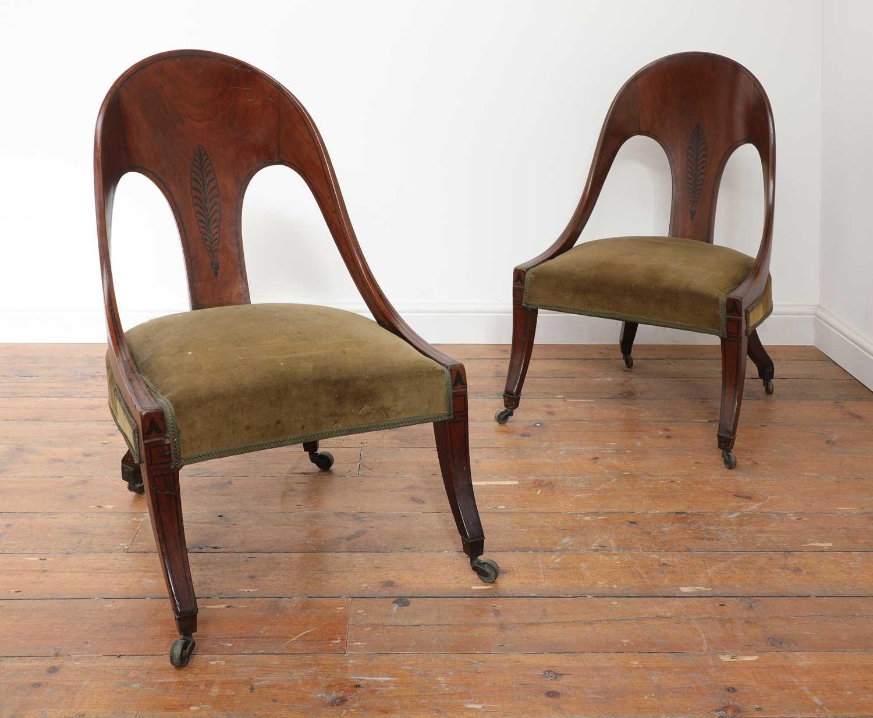A pair of Regency mahogany klismos chairs,