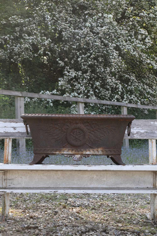 A cast iron planter,