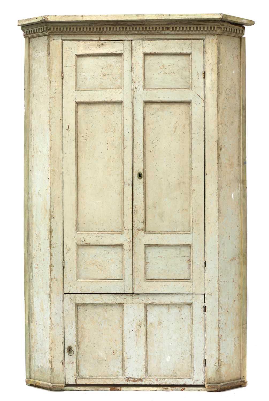 A large George III painted pine corner cupboard,