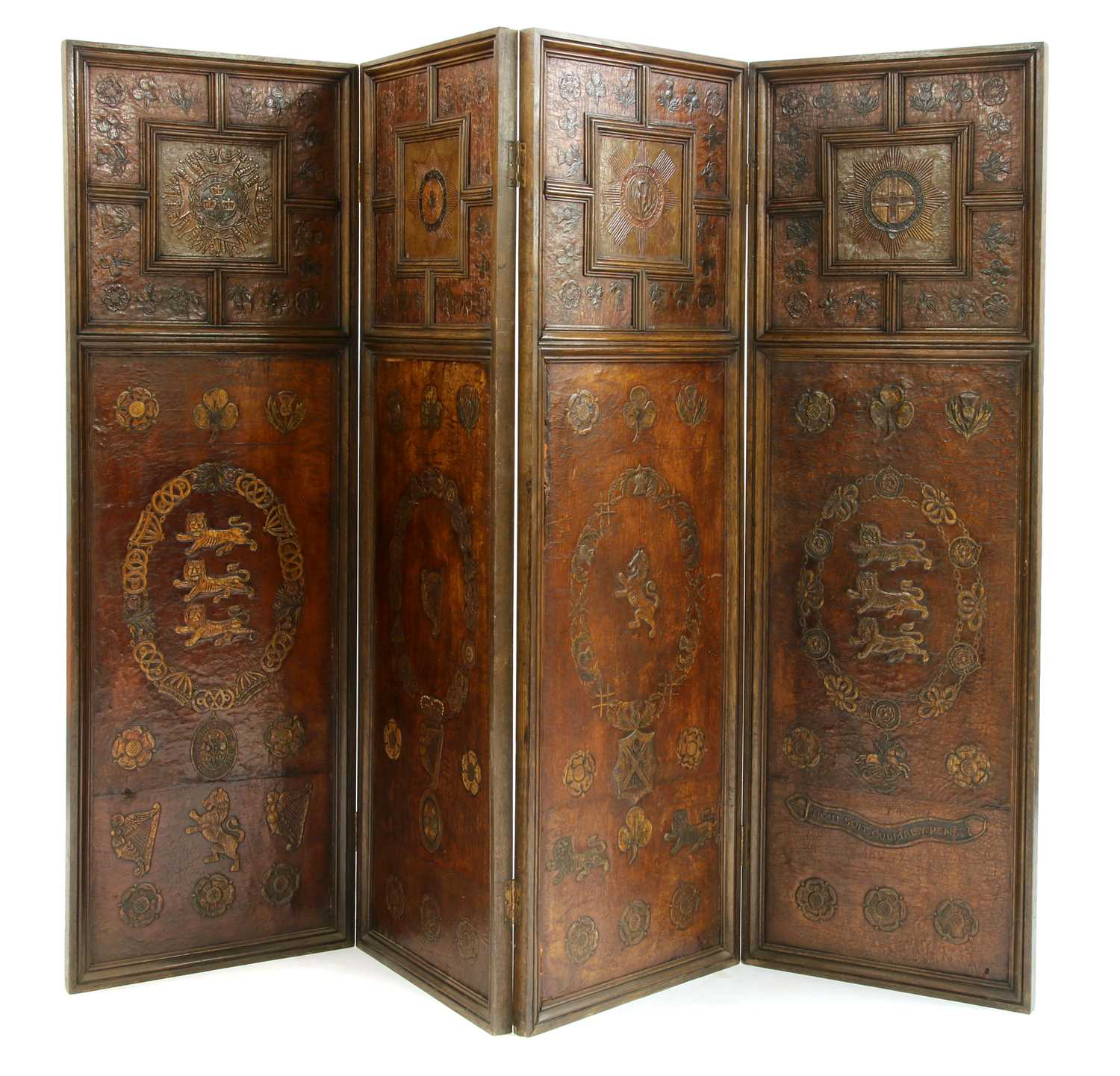 An oak and embossed leather four-fold screen,