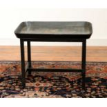 A Regency black lacquer galleried tray on stand,
