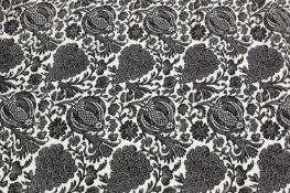 A pair of black and white lined and interlined curtains,