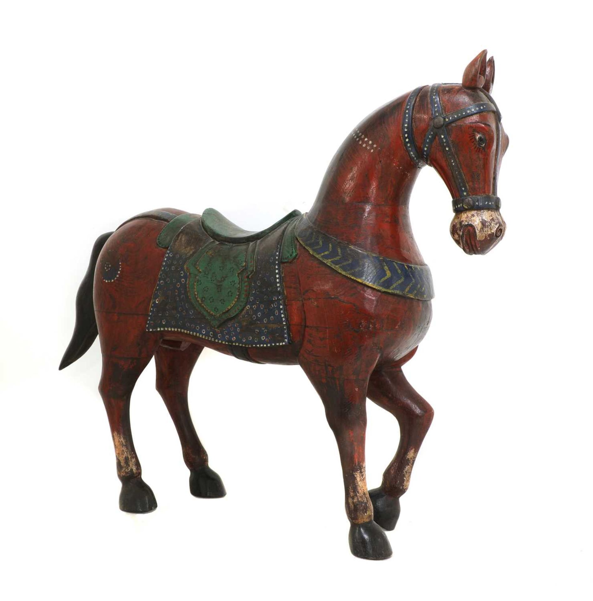 An Indian polychrome painted wooden horse,
