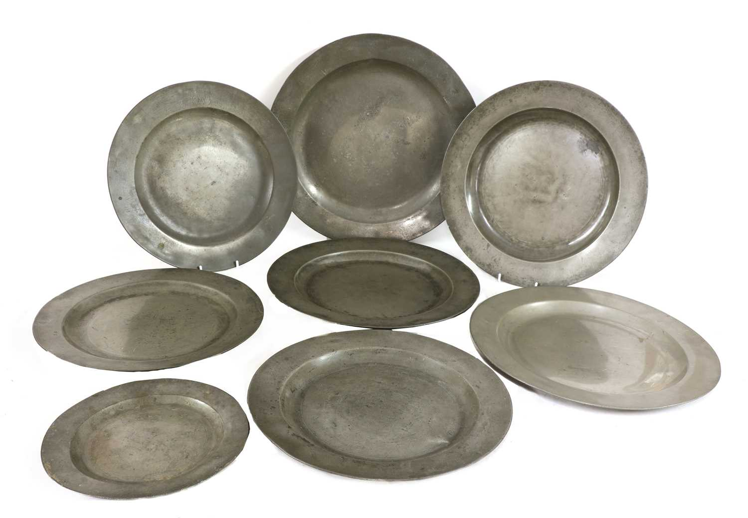 Eight pewter plates,