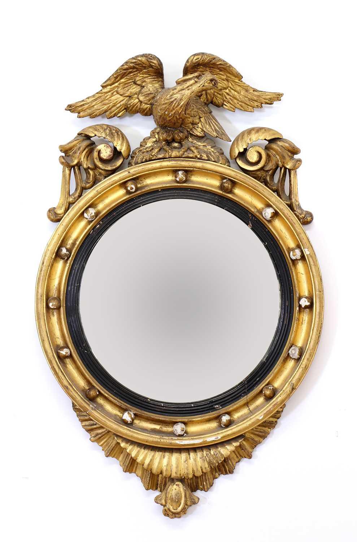 A Regency period circular gilt eagle wall mirror,