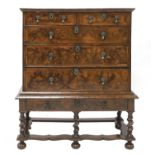 A William and Mary walnut and feather-banded chest on stand,