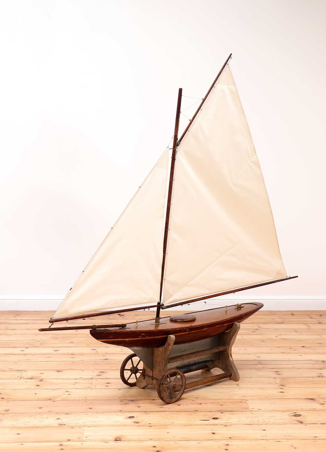 A large rigged pond yacht,