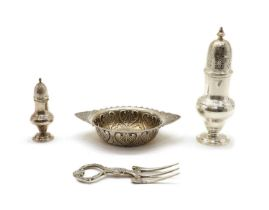 A silver sugar shaker of baluster form,