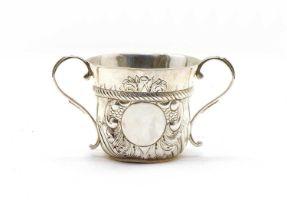 A William and Mary style Britannia silver porringer,