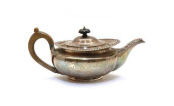 A silver teapot,