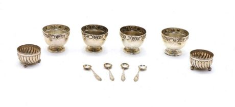 A set of four Edwardian silver table salts,