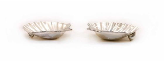 A George III silver butter shells,