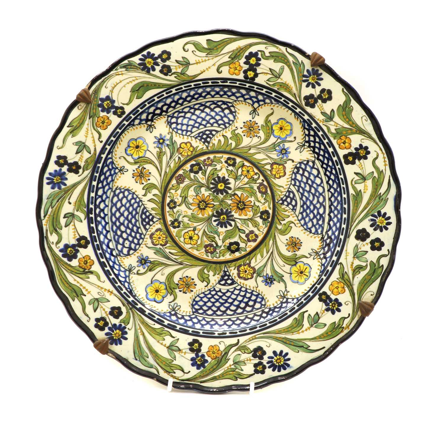 A Continental pottery charger,