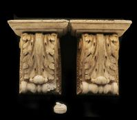 A pair of neoclassical reconstituted stone corbels,