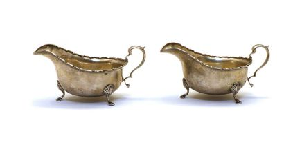 A pair of silver sauceboats,