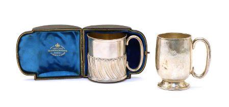 A cased Victorian silver christening mug,