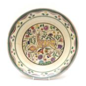 A Poole Pottery charger,