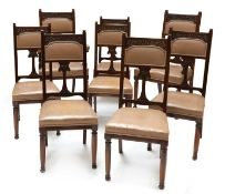 A set of eight Art Nouveau walnut dining chairs,