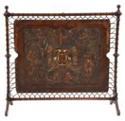 An embossed leather and walnut fire screen,