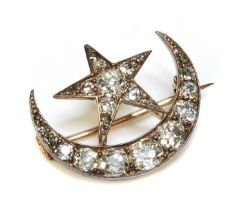 A late Victorian diamond set crescent and star brooch,