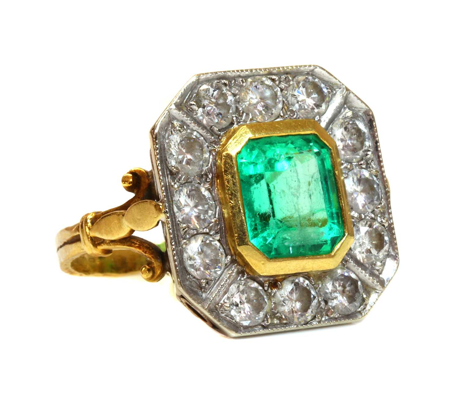 An 18ct gold emerald and diamond octagonal cluster ring,