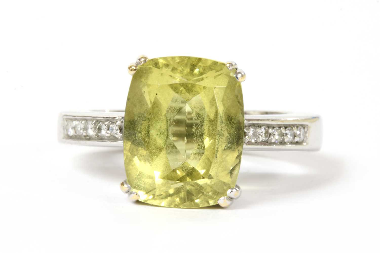 A gold heliodor and diamond ring,