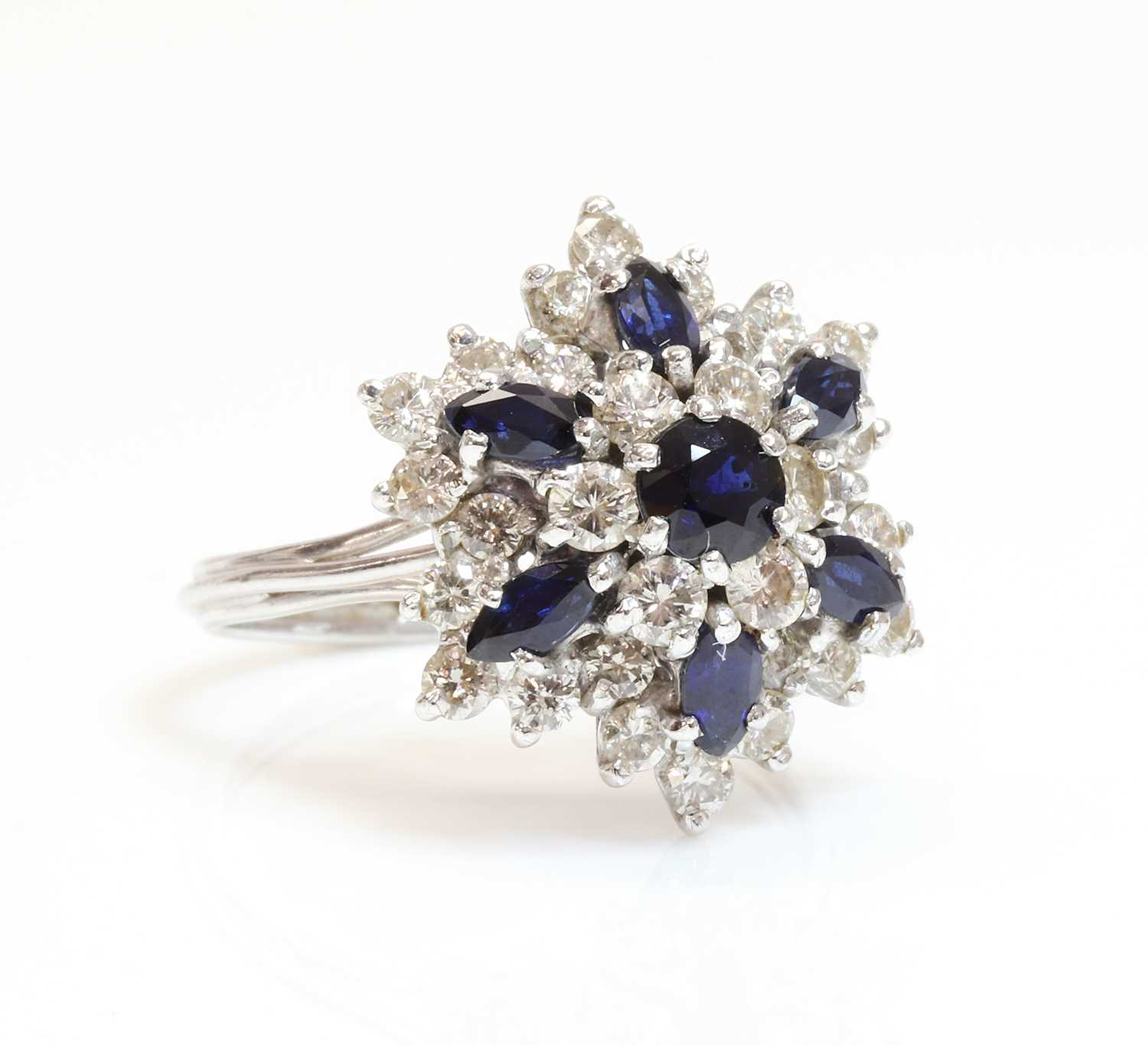 A white gold sapphire and diamond snowflake cluster ring,