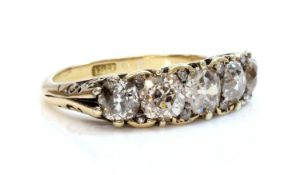 A five stone diamond carved head ring,
