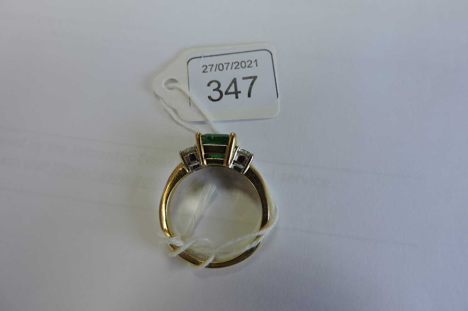 An 18ct two colour gold three stone emerald and diamond ring, - Image 4 of 4
