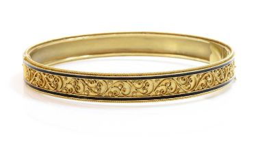 A Victorian archaeological revival Etruscan style gold and enamel hinged bangle, c.1870,