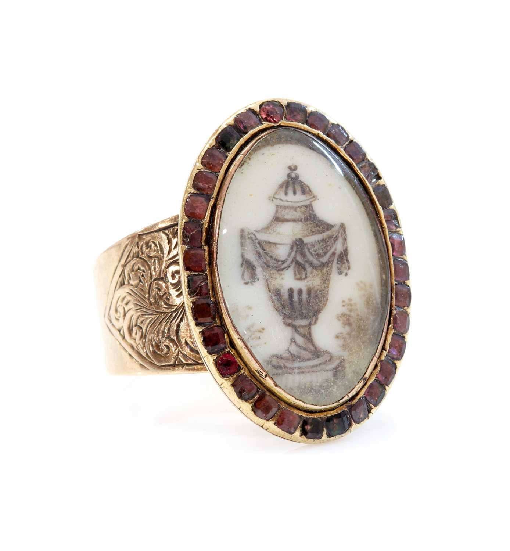 A Georgian garnet set memorial ring,